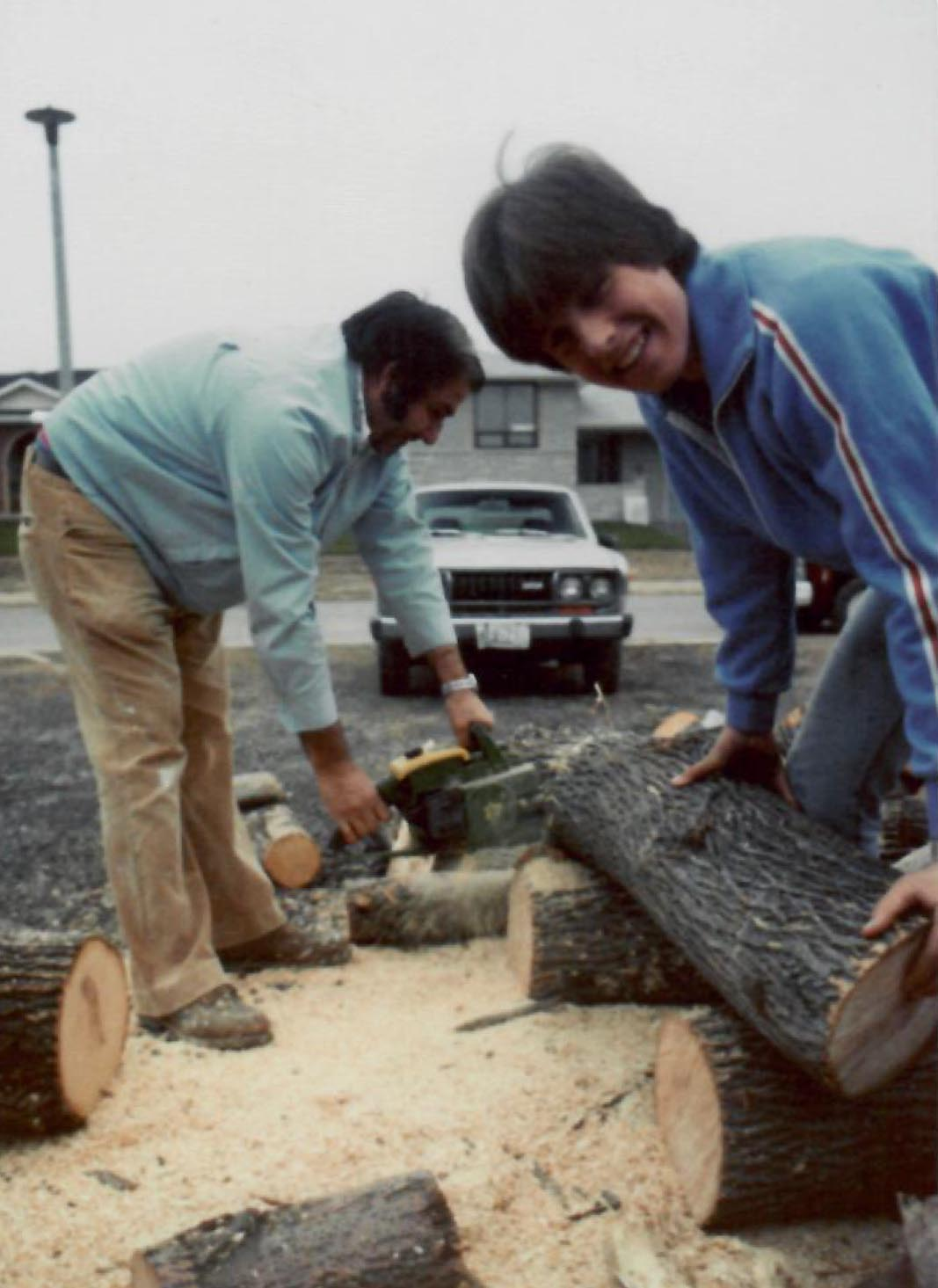 1980s - Gabriele and Domenico cutting firewood on Bridlewood Drive